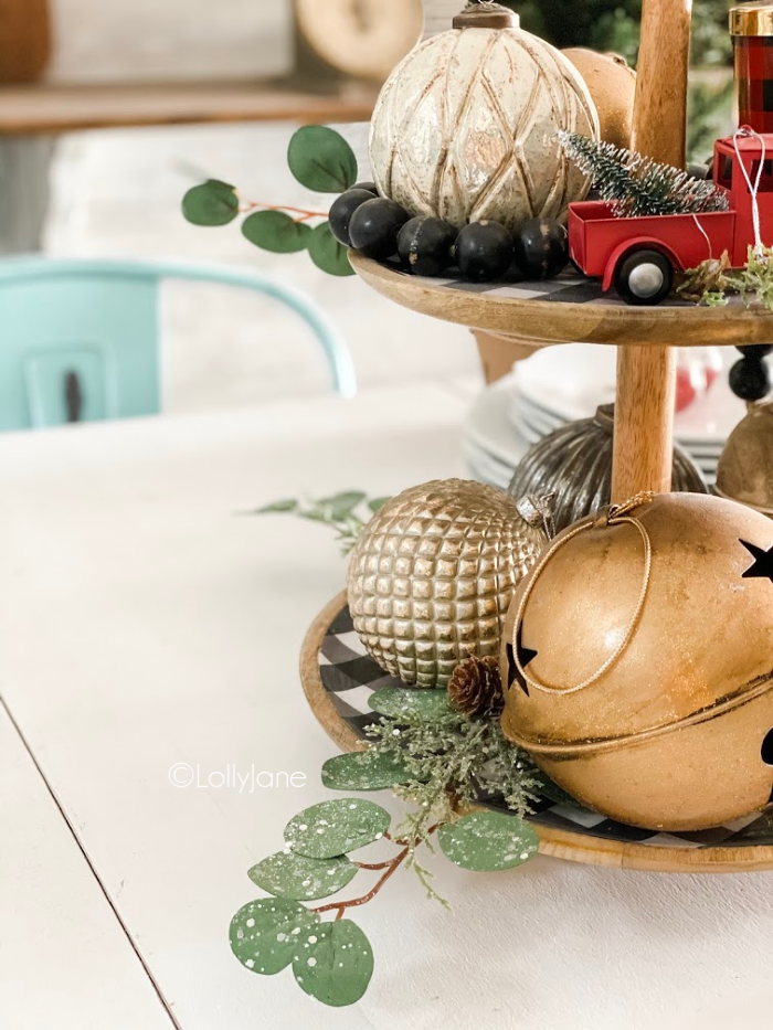 Loving these neutral tiered tray decor ideas to decorate from Christmas until after the New Year! Consider transitional decor when decorating for the holidays! #neturalholidaydecor #farmhousechristmas #modernchristmasdecor #tieredtraydecor #easytieredtraydecor