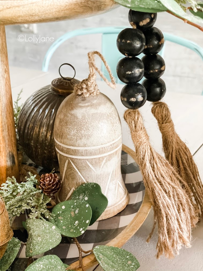 Easy New Years party decor ideas using black and white accents with neutral pieces. #newyearspartyideas #newyearstieredtray #wintertraydecor #wintertieredtrayideas