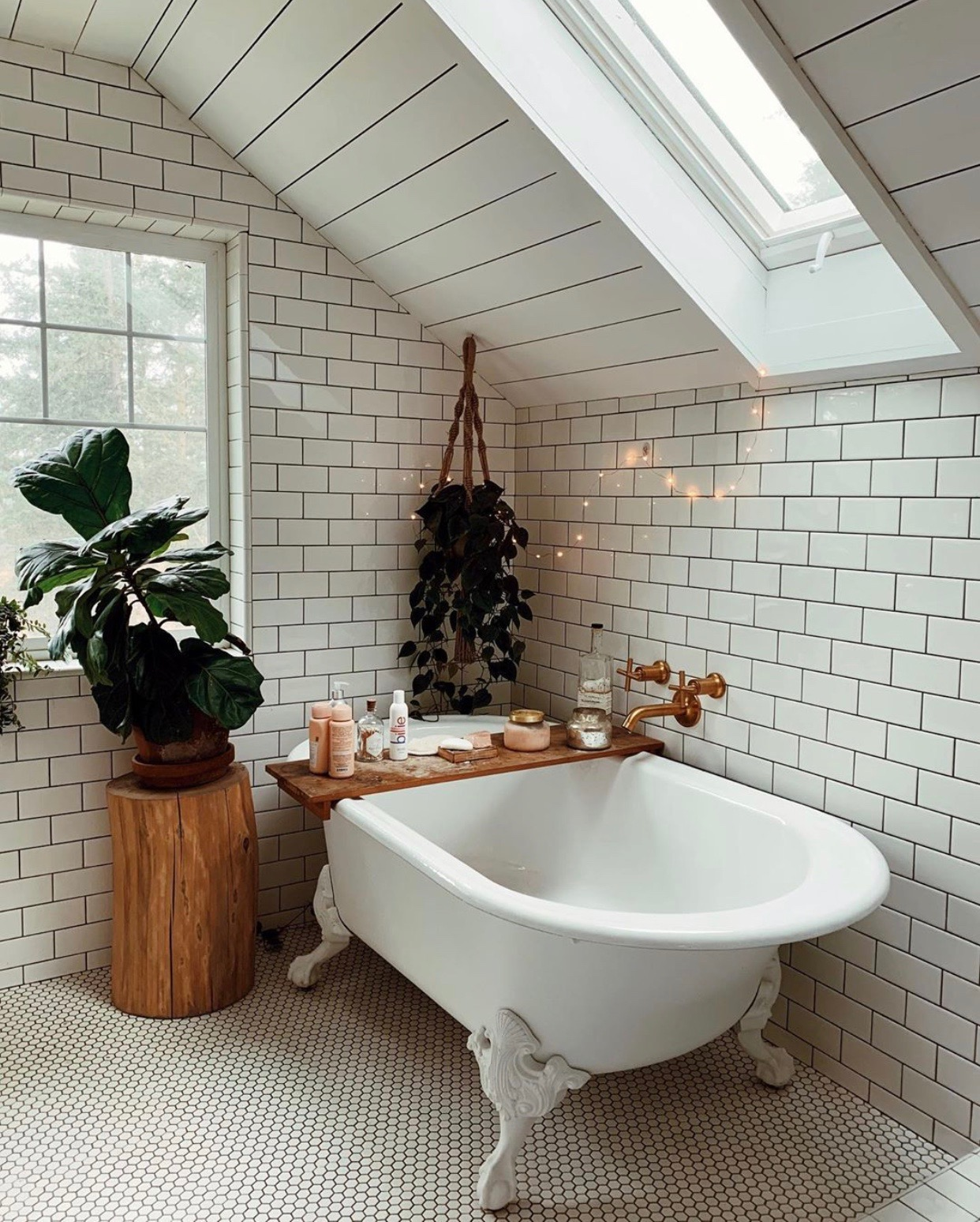 Dreamy Vintage Bungalow Style Bathroom... that subway tile/skylight combo is DREAMY! #vintage #farmhousebathroom #bathroomreno #fixerupper