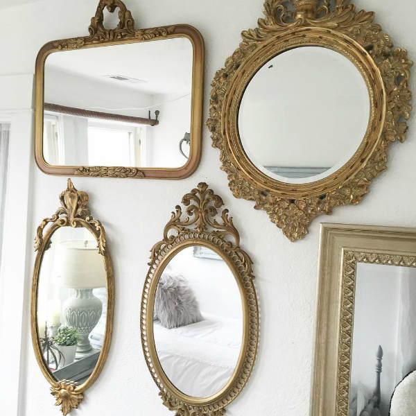 Hallstrom Home created this darling bedroom mirror gallery wall for her daughter's space. So pretty! #goldgallerywall #goldmirrorgallerywall #bedroomgallerywall #bedroommirrorgallerywalldecor #gallerywalldecor