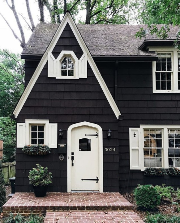 Gorgeous black house with white trim! Adore this exterior paint ideas for a lovely cottage home with dark paint and light trim. Such a pretty contrast! #blackandwhitehouse #darkhouse #darkhousepaint #exteriorpaintcolors #blackpaintedhouse #blackexteriorpaint #blackandwhitehouse