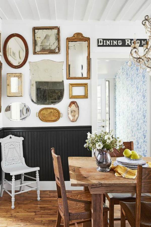 Looking to make a dining room feel bigger? Group antique mirrors together to create this gorgeous dining room mirror gallery wall. #mirrorgallerywall #gallerywallmirrordecor #diningroommirrors #diningroommirror #mirrorwallgrouping