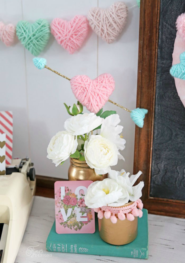 Adore these DIY Dollar Store Yarn Wrapped Hearts, so easy to make and lots of ways to customize them! #yarnhearts #diyyarnhearts #diydollarstorecraft #dollarstorecrafts #valentinesdaydecor #vdaydecor