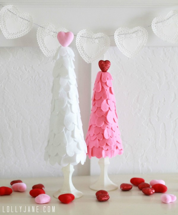 See how easy it is to make this DIY Dollar Store Felt Heart Trees. Lots of cutting but super easy and affordable! #dollarstorecraft #dollarstoreholiday #valentinesdaydecor #valentinesdaydollarstore