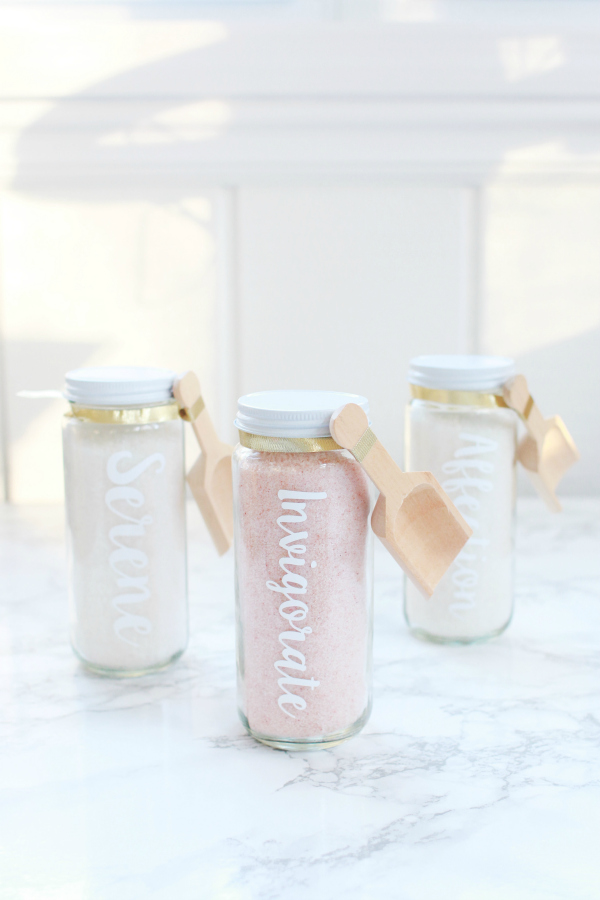 This is such an easy diy infused bath salts recipe. Package it in pretty glass containers for the perfect Galentines Day gift! #giftidea #handmadegifts #handmadegiftidea #bathsaltsrecipe #infusedbathsalts