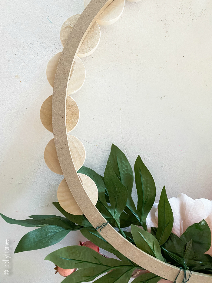 How to make a Wood Bead Wreath, so easy! Grab these supplies to make the easiest statement piece for your own front door! #wreath #wreathdiy #diywreath #springwreath #wreathsofinstagram #diyspringdecor #springdecor #woodbeadwreath