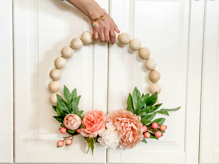 EASY to make for DIYers of any level, click through for the simple how-to! Wood Bead Wreath with Florals that perfect for spring or any time of year! #wreath #wreathdiy #diywreath #springwreath #wreathsofinstagram #diyspringdecor #springdecor #woodbeadwreath