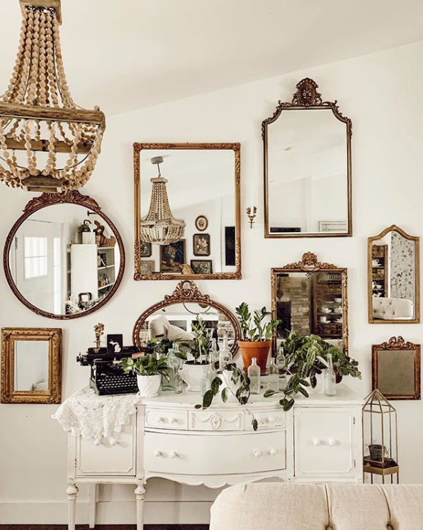 Adore this white buffet under this mirror gallery wall entryway decor for stunning decor. Such a pretty farmhouse entryway, wow. #entrywaydecor #entrywaymirrorgallerywall #entrywaygalleryideas #mirrorgallerywalldecor