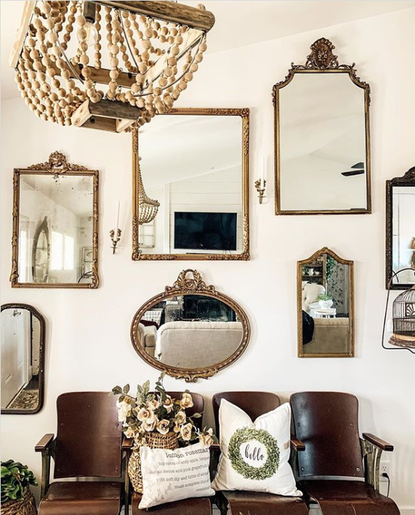 Add a grouping of gold mirrors to an entryway wall surrounding a bench for easy wall treatment ideas. #mirrorgallerywall #gallerywalldecor #mirrorgallerywall #mirrorgallerywalldecor