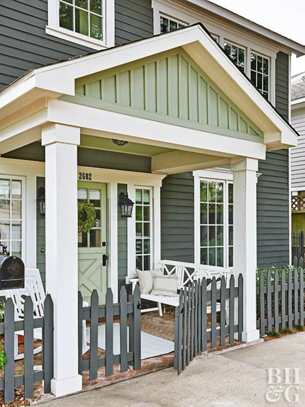 Holy! Adore this gorgeous dark gray and green two tone painted house. I recently added board and batten gables to our own home so I'm partial to this green board and batten. It's so pretty, bold yet classic. #boardandbattenexterior #greenexteriorhome #grayexteriorhome #darkpaintexterior