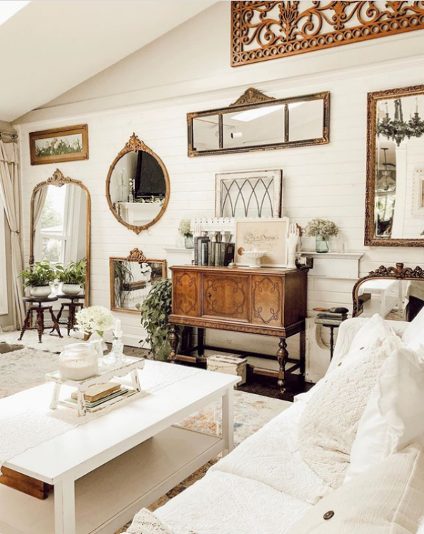 Check out this mirror gallery wall family room decor, so pretty! Add mirrors and frames to fill a large wall! #farmhousefamilyroomdecor #mirrorgallerywall #mirrorwall #hangingmirrorideas #mirrorgallerywallideas #farmhousemirrorcollection