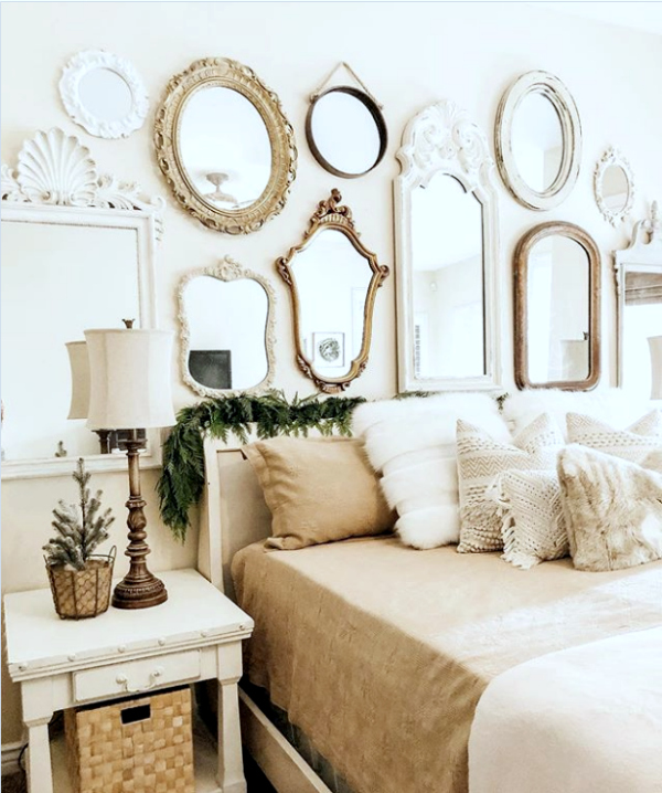 Wondering what to put above your bed? Add mirrors above your bed for a pretty mirror gallery wall decor idea! #masterbedroomdecor #masterbedroomgallerywall #mirrorgallerywall #bedroommirrorgallerywall