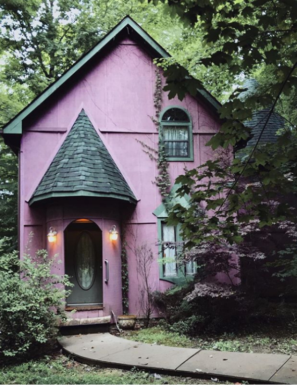 What a bold statement with this dark painted exterior house: a purple painted house! Such a fun house color if you're looking to go colorful! #purplepaintedhouse #purpleexterior #darkexterior #darkhousecolors