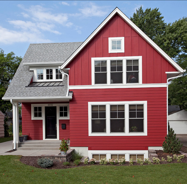 Love this red painted house, so pretty with crisp white trim! Looking for dark exterior painted houses? Check out all these bold hues! #redhouse #redexterior #redpaintedexterior #darkexterior #darkexteriorpaint