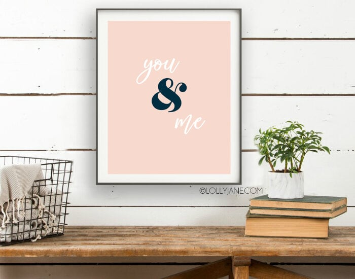 You and Me printable art! Love this simple Valentines Day print for an easy wall treatment! Looking for easy Valentines Day decorations? Save and print this pink you and me Valentine's Day printable art! #valentinesdaydecor #loveprint #allyouneedislove #allyouneedisloveprint #printableart #vdayart