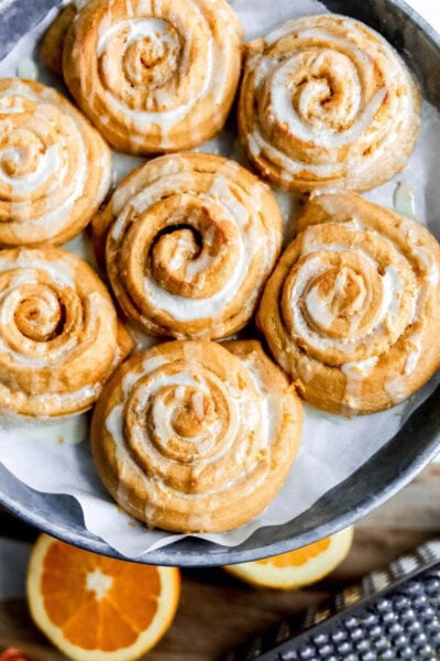 Clean Simple Eats zesty orange sweet rolls are the perfect weekend treat, yum! Try this healthy version of gooey orange rolls, guilt free! #cse #cleansimpleeats #orangerolls #sweetrolls #orangesweetrollsrecipe