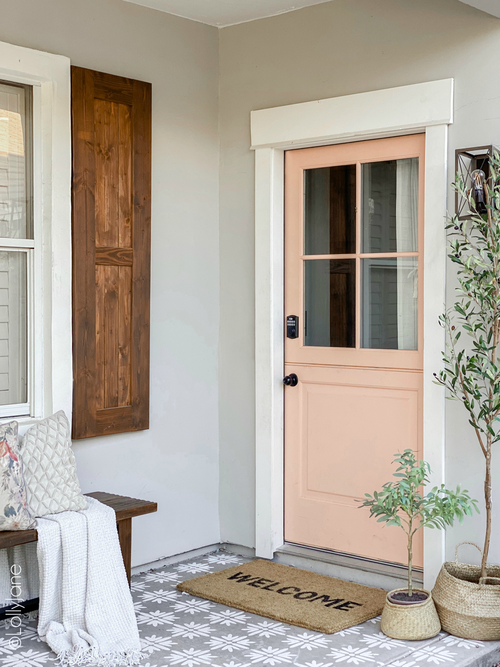 Classic craftsman style home with a pop of pink, so good! GORGEOUS Front Porch Makeover, check out the before-- WOW! #diy #stencil #Dutchdoor #pinkdoor #makeover #porchdecor #porchmakeover