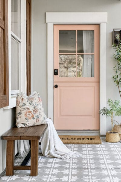 GORGEOUS Front Porch Makeover, check out the before-- WOW! Classic craftsman style home with a pop of pink, so good! #diy #stencil #Dutchdoor #pinkdoor #makeover #porchdecor #porchmakeover