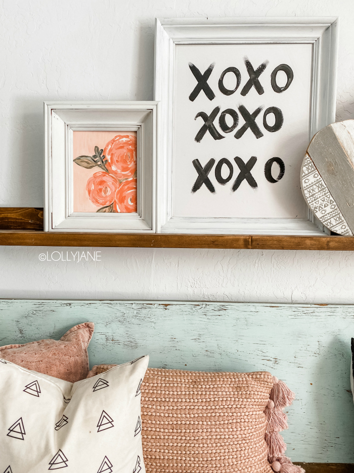 Have an old canvas lying around? Don't pass up that next thrift store canvas, paint it! Pair a diy floral canvas with a hand painted xo canvas to create CHEAP Valentines Day decor!! Love this black white and pink decor, too cute! #manteldecor #xoxo #valentinesdaymantel #valentinesdayshelf #floralvalentinesdecor