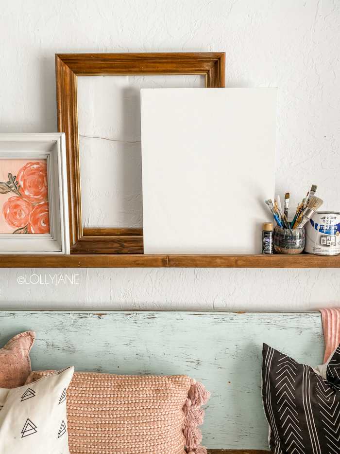 How to frame a canvas easily: place it inside a picture frame!! No cutting required! So easy to match your style, just paint the picture frame! #easydecor #easydecorideas #pictureframehack #pictureframecanvas #pictureframehack #canvashack #howtoframecanvas
