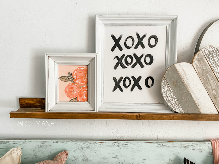 Frame a canvas with picture frames for no fuss framing! Simply add a canvas to the back of a picture frame for a diy custom canvas frame, EASY! #framedcanvas #diycanvas #pictureframehack #canvashack #diycanvas #paintedcanvas