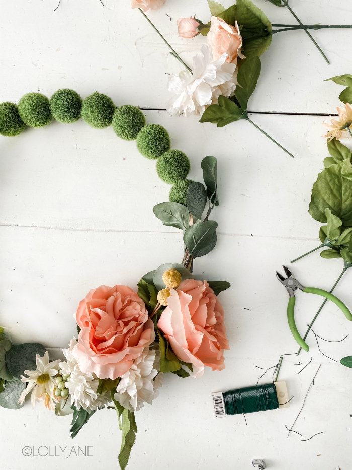 How to make a floral wreath with a few supplies, most of them you probably have on hand in your craft stash! Follow these easy directions to make a flower wreath for spring! #howtomakefloralwreath #flowerwreath #diy #howtomakeawreath #floralwreathinstructions #springwreath
