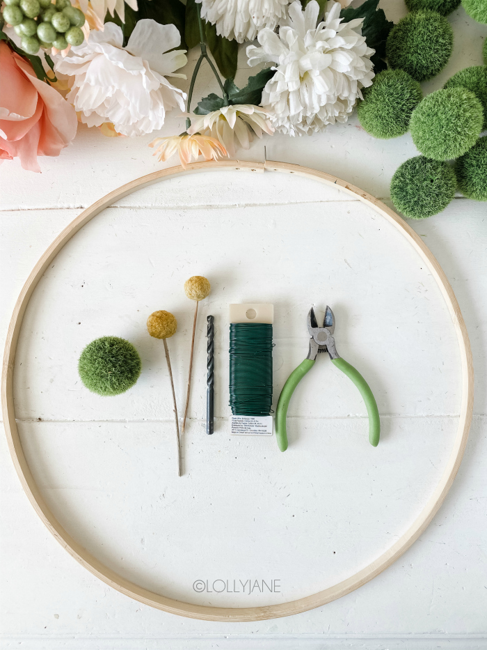 How to make a moss ball floral wreath, so easy! Grab these supplies to make a moss spring floral wreath using thrifted items and an embroidery hoop wreath. #springwreath #diywreath #floralwreath #mossballfloralwreath #mossballcraft #wreathdiy