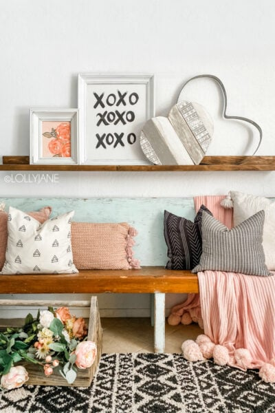Looking for easy Valentines Day decor? Check out our hand painted canvases then frame them in thrifted picture frames. SO EASY and so affordable! #framedcanvas #diyframedcanvas #framedcanvashack #diyframedcanvas #valentinesdaymantel #vdaydecor