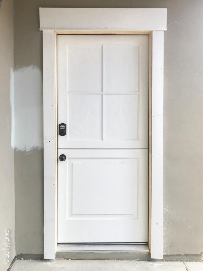 New Craftsman Style Dutch Door to make a builder grade house look custom! #diy #stencil #Dutchdoor #pinkdoor #makeover #porchdecor #porchmakeover