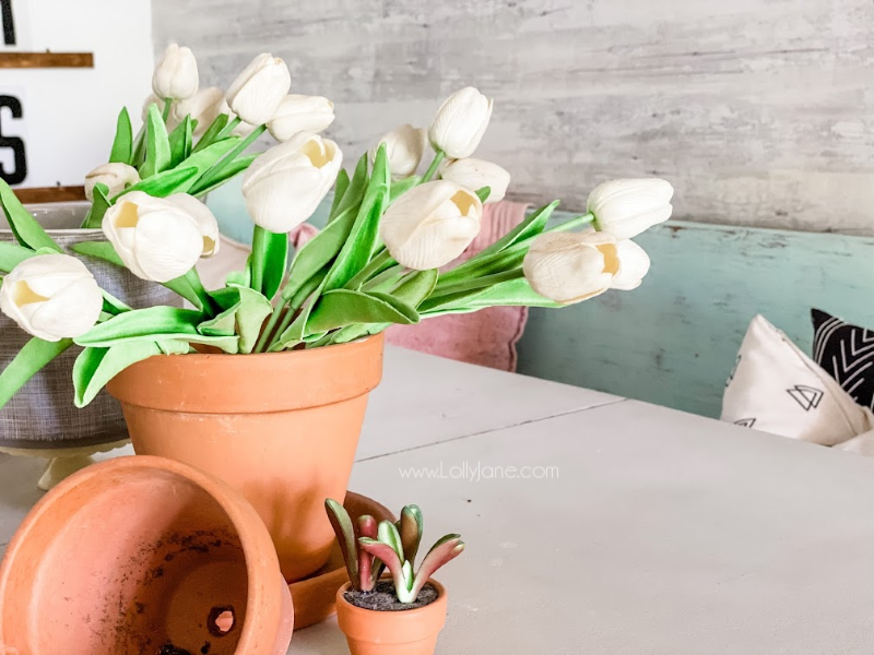 Looking for easy spring decor? Set tulips in terracotta pots for an easy spring decor table scape! Love decorating for spring, great way to welcome the new year! #springdecor #decoratingforspring #springdecorations #springtablescape #tulipdecor
