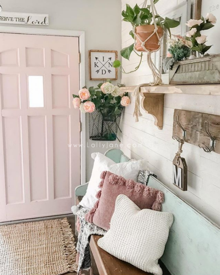 Such fun pink double doors in this shiplap entryway. Check out the newly added double dutch doors, a great way to add natural light to your home. #dutchdoor #frontdutchdoor #exteriordutchdoor #doubledutchdoors #frenchdutchdoors #farmhousedutchdoors