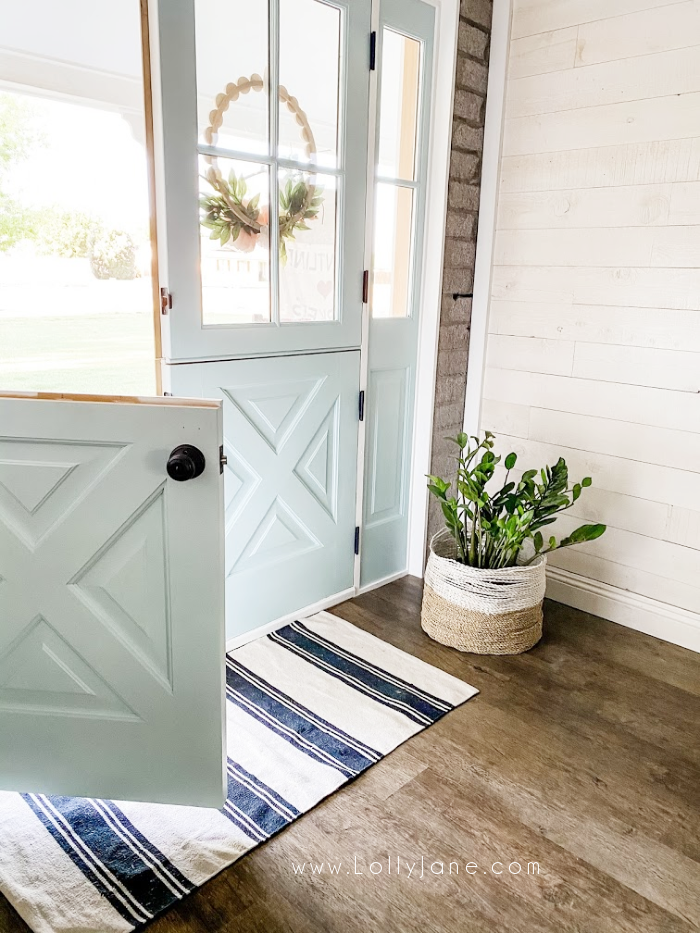 In love with these custom interior double dutch doors. The prettiest blue dutch doors that offer a farmhouse vibe. #dutchdoor #doubledutchdoors #frenchdutchdoors #farmhousedutchdoors #dutchdoor #simpsondutchdoor
