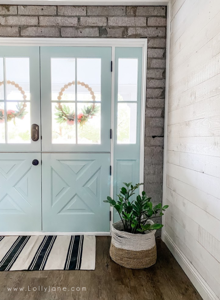 Love these painted doors in the color Natures Refection from Behr. Such pretty painted blue dutch doors. #dutchdoors #doubledutchdoors #frenchdutchdoors #howtoinstalldutchdoors #bluedutchdoors #farmhousedutchdoors