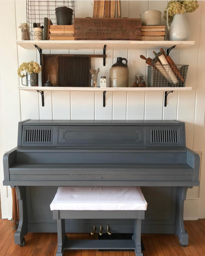 Such a classy dark gray painted piano. What a lovely painted piano in this pretty farmhouse home! #farmhousedecor #paintedpiano #darkgraypaintedpiano #graypiano #farmhousepiano