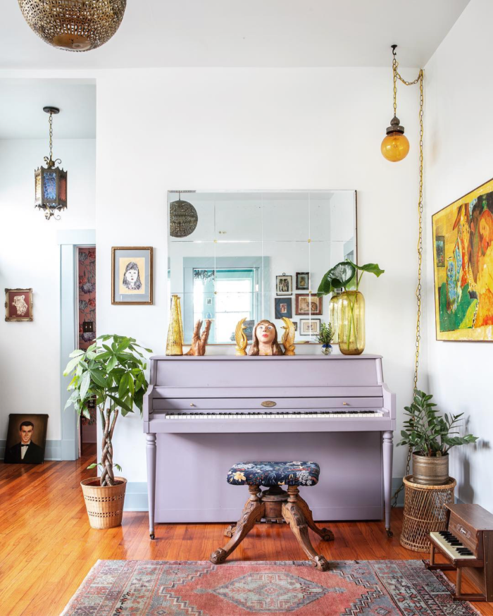 Loving this bold lavendar painted piano. Such a fun statement piece in this eclectic boho style room! #lavendarpaintedpiano #paintedpiano #purplepiano #paintedpurplepiano #diypiano