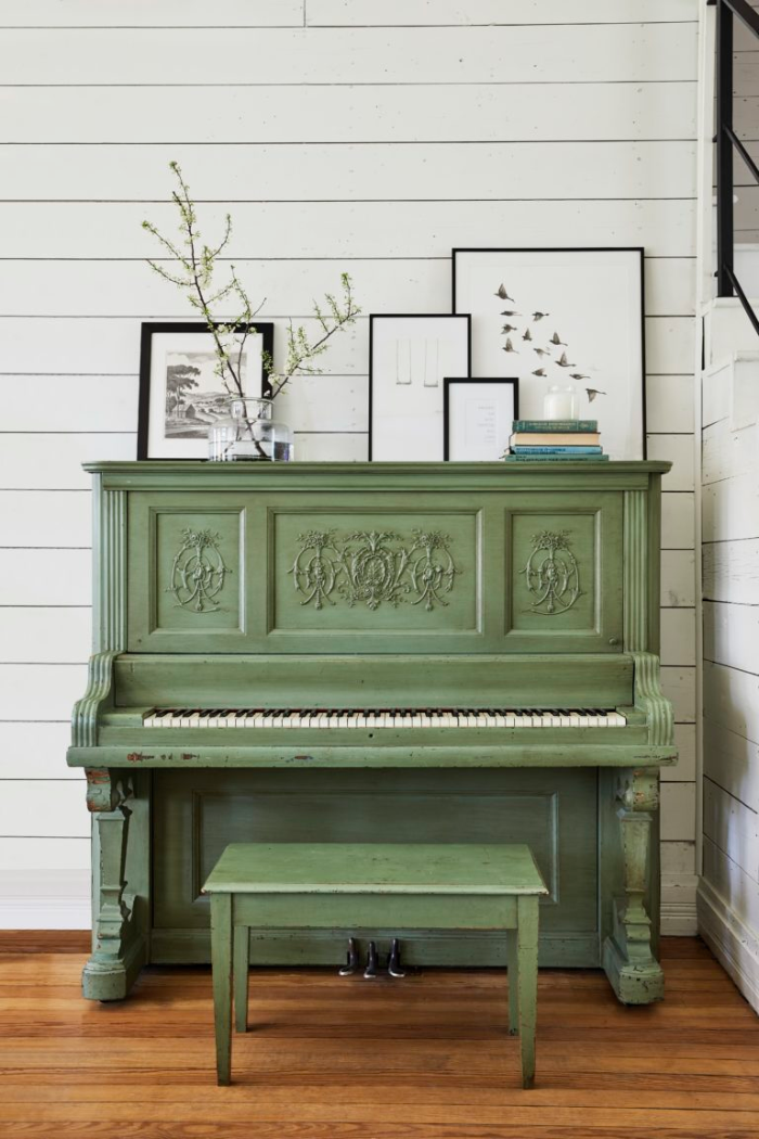 Dark green is trending so hard right now but we think this olive green painted piano will be a classic for a long time. #greenpiano #farmhousestylepiano #farmhousedecor #shiplapwallpianoideas #olivegreendecor #olivegreenpiano #paintedgreenpiano