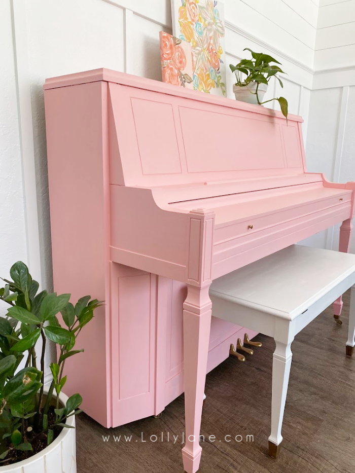 You only need a little paint and a couple hours to transform a dull piano into a happy work of art! This tutorial shows you how easy it is to paint a piano. #howtopaintpiano #paintedpiano #pinkpiano #pinkpaintedpiano #paintedpianotutorial
