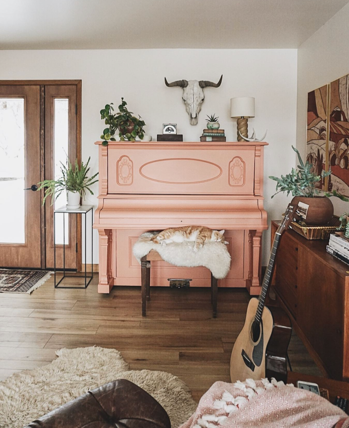 If you're looking for ways to style a boho room around a piano, this is it! Such a fun twist on a pink piano with this terra cotta painted piano! #bohodecor #bohostyle #paintedpiano #pinkpiano #terracottapiano