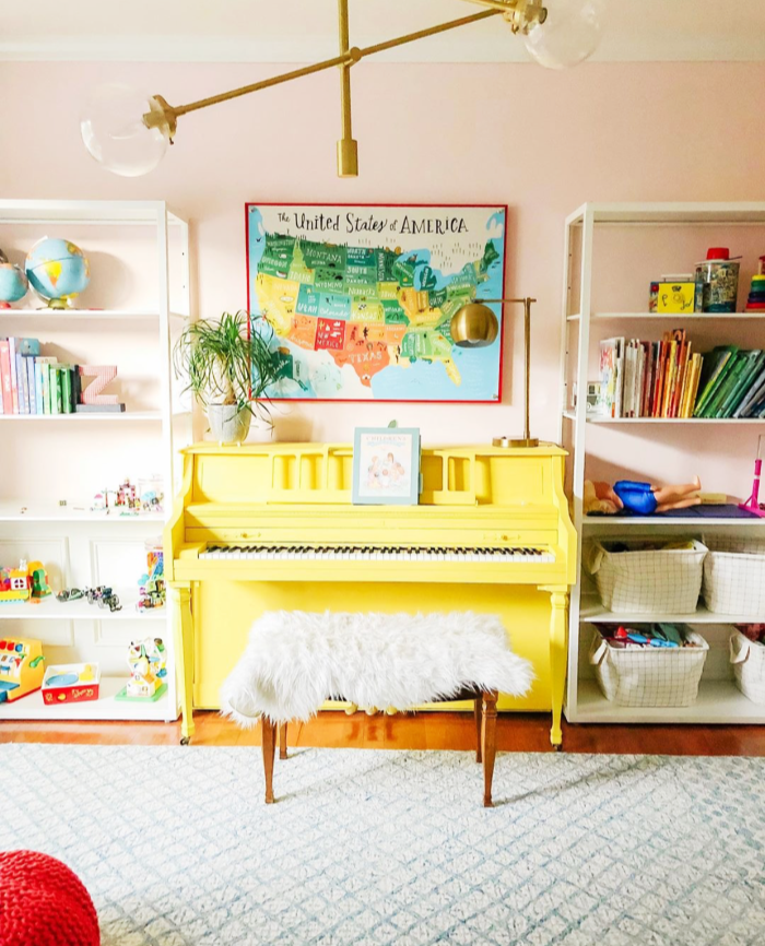 What is more cheerful than a happy yellow painted piano? We're loving this ray of sunshine! #paintedpiano #yellowpaintedpiano #paintedpianoideas #eclecticdecor #howtodecoratearoundapiano