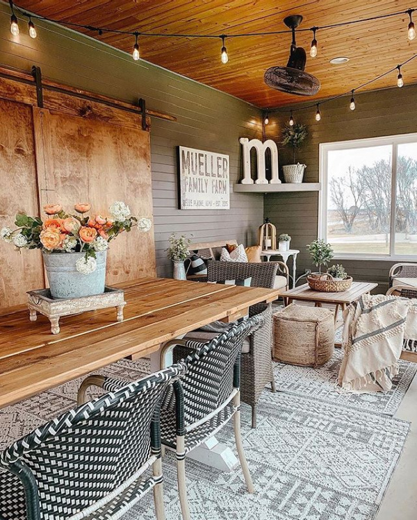 So in love with this farmhouse sunroom. It's the perfect spot to gather family on this beautiful outdoor rug. #farmhouserug #modernfarmhouserug #cozyoutdoorspaces #outdoorrug #farmhosueoutdoorrug #sunroomdecorideas