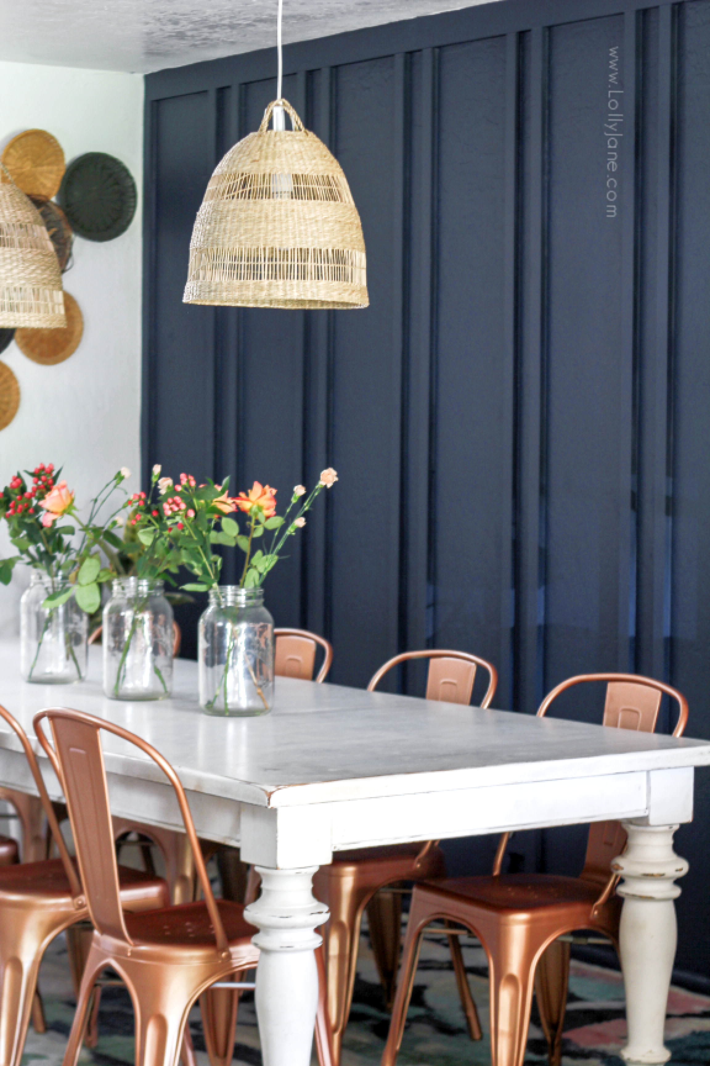 Are you looking for ways to decorate your dining room with a boho style? Get ideas for modern minimalist furnishings and decorative accents on a budget! #bohostyledecor #bohodiningroom #navydiningroom #boardbattendiningroom #doublebatten #walltreatmentdiy #diywalltreatment #diyboardbatten