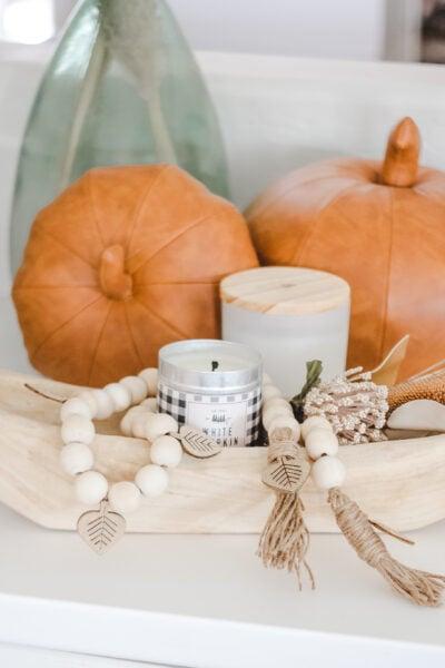 How to make a wood bead garland, fall style! #fall #falldecor #leaftcraft #fallcraft #fallhhomedecor #diy #diyfalldecor #falldecorations