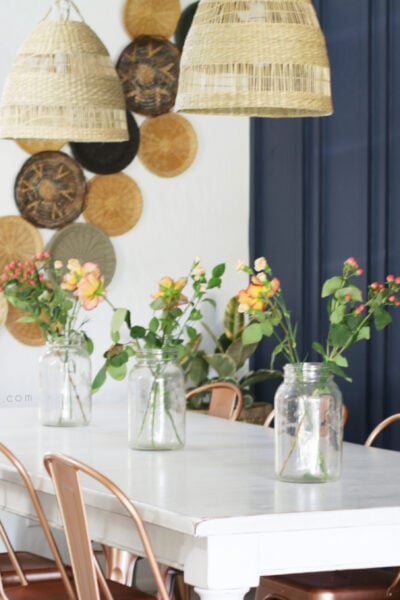Love this easy boho basket wall tutorial! Such a cute and cozy boho dining room with super cheap ways to get this look! #bohowalldecor #bohobasketdecor #wickerbasketwalldecor #rattanbasketwall