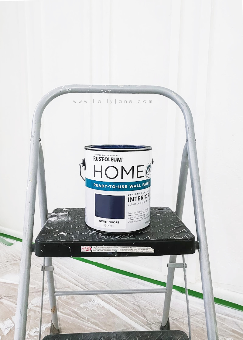 Loving this gorgeous shade of navy wall paint! Rustoleum North Shore navy paint goes on smooth and has a buttery soft finish. Come learn how to spray it on for a smooth finish! #rustoleumnorthshore #navybluewallpaint #navydiningroomwall #navydiningroom #navywallpaint #navywallpaintideas #navydiningroomwallideas