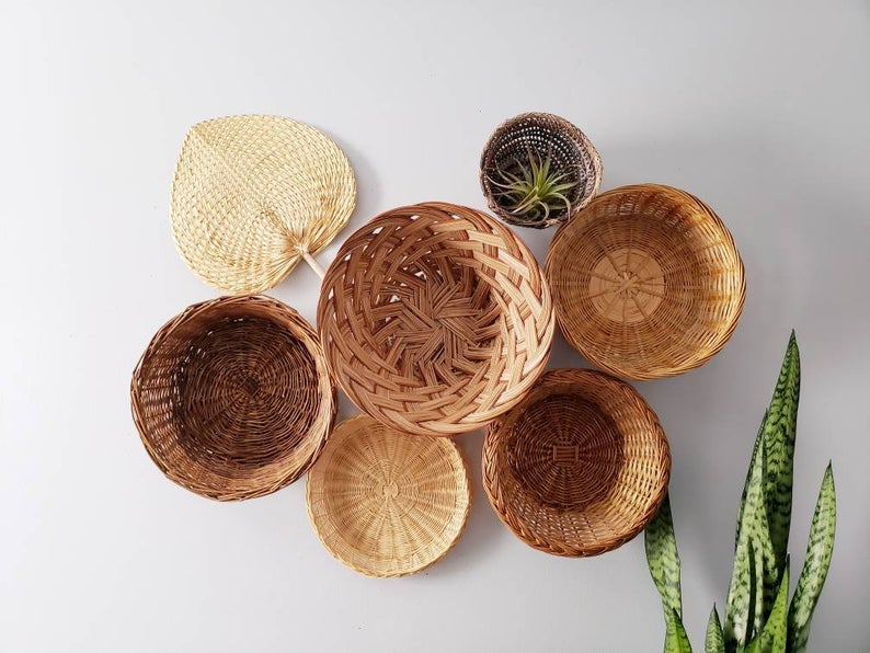 Use wicker plates on wall to create an easy boho basket wall art! Such a fun diy basket wall boho style! Adore this wall basket decor made from rattan plates on the wall. Such fun trendy wicker basket decor! #bohostyle #wickerbohowall #rattanwallcollection #basketwalldecor #basketwalltreatment #etsyshopdecor #bohoetsybaskets #wheretobuybohobasketcollections