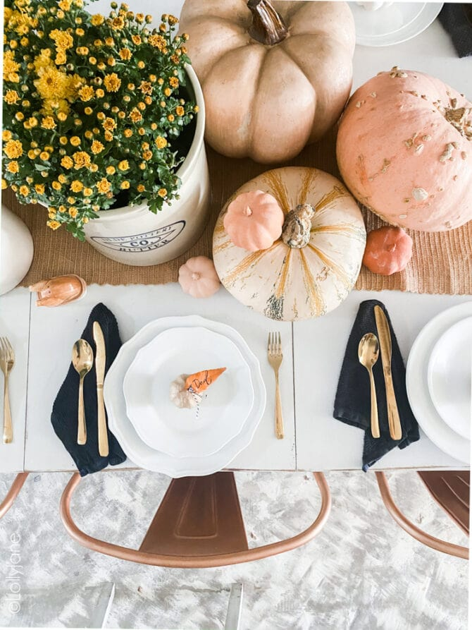 Cute and easy fall style name cards, just paint leaves + tie onto faux or real pumpkins. So easy! #thanksgiving #fallparty #placecards #namecards #diy #falldecor #falldecorations