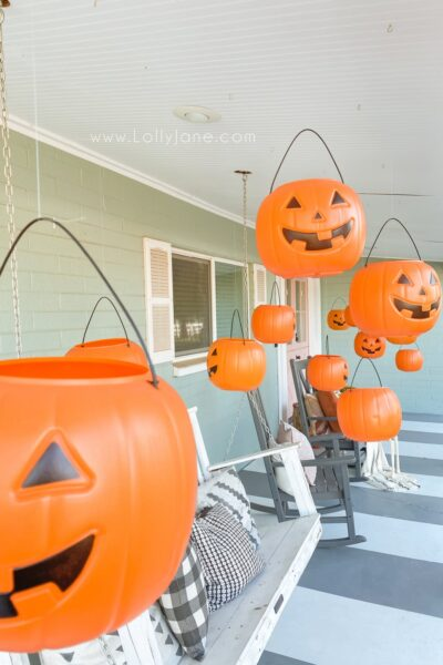 Level up dollar pumpkins for easy Halloween decoration. BONUS: They light up! #dollarpumpkindecor #plasticpumpkinshalloweendecor #hangingpumpkinsporchdecor #hangingpumpkinsoutdoordecor #halloweenoutdoordecor #halloweenporchdecor #halloweenporchpumpkindecor #howtohanghalloweendecor #diyhangingpumpkins