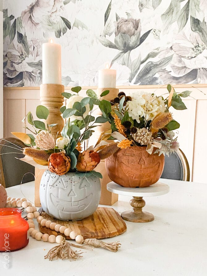 Darling cement pumpkin planters! Make these cuties in no time at all, perfect for fall and Halloween!