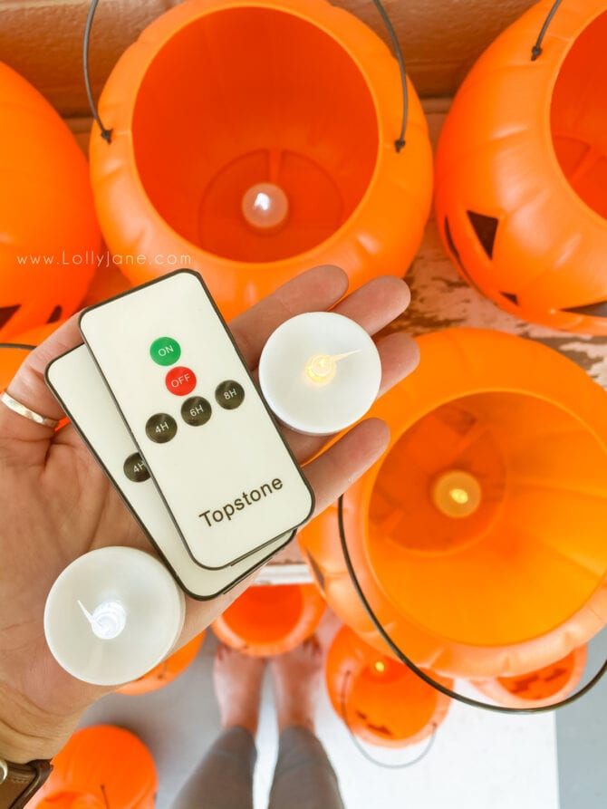 Add remote control tea lights as Halloween pumpkin filler to light it up. SO cute and saves so much time from turning them on manually! #besttealights #batteryoperatedtealights #remotecontroltealights #ledtealights #howtolightuppumpkins #besttealightsforjackolanterns #tealightpumpkins #halloweenoutdoordecor #outdoorhalloweendecor #halloweenporchdecor #halloweendecorationsoutdoors