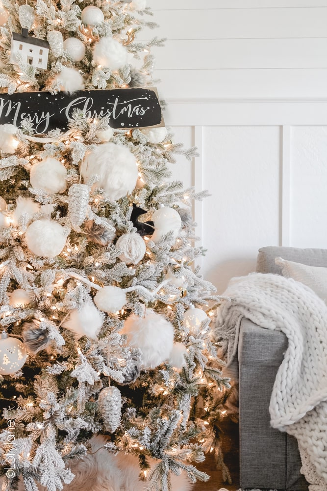 Add some winter items like ice skates, village houses, antlers to make your Christmas tree wintery! #Christmas #christmasdecor #christmasdecorations #iceskates #ChristmasTree #ChristmasTreeTheme #whiteblackchristmastree #christmastreetheme